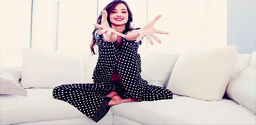 Miranda Kerr in pajamas on the couch 3